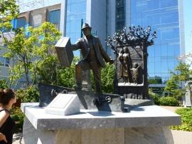 10. The Emigrant sculpture