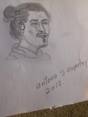 42. Pendant que nous nous reposons sur un banc, un artiste croque Quentin et nous donne son dessin...